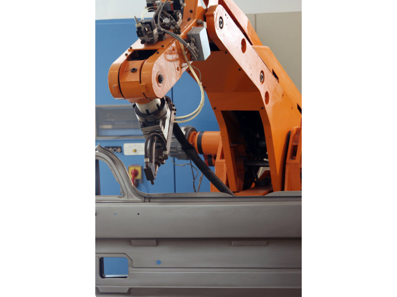 Spot welding robot arm